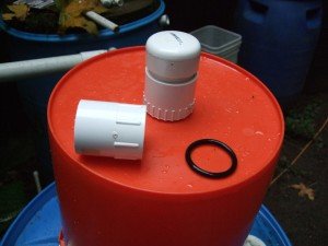 Here you are looking at the bottom of the top bucket from the outside. Note the 1/16 inch hole drilled in the 2 inch slip cap. There are 4 of them equally spaced around the cap. This makes water flow indirectly to the sand; not disturbing the schmutzdecke. The O ring actually goes on the inside of the bucket between the adapters.